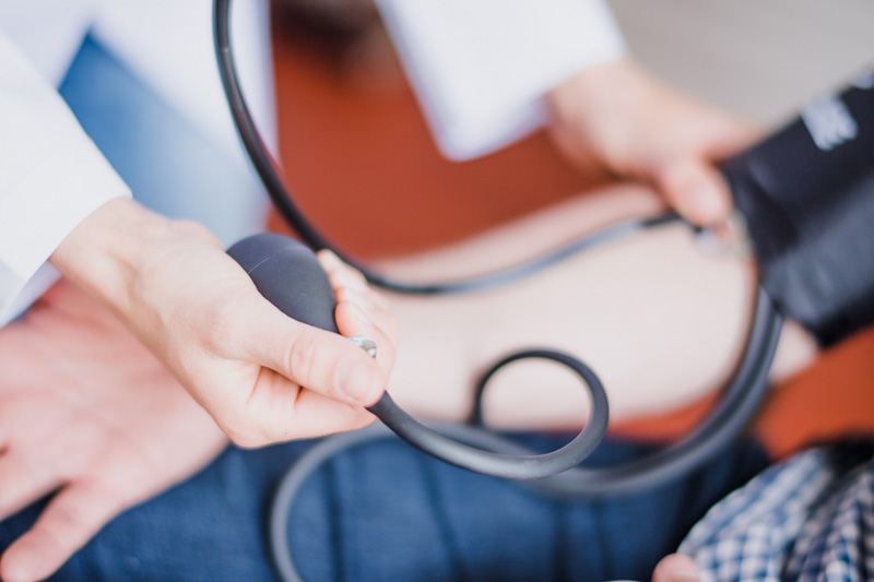 Doctor and blood pressure measurements